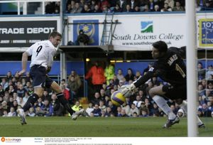 Portsmouth v Everton Portsmouth's David James saves from Everton's James Beattie