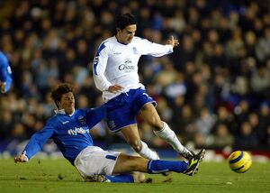 Tim Cahill is tackled