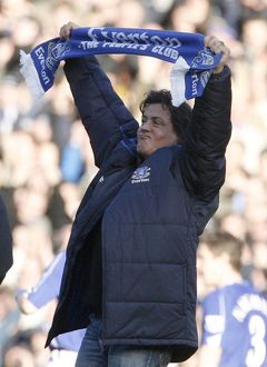 U.S. actor Stallone holds a scarf as he walks on the pitch at the English Premier
