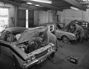 Cortina Mk 2 and Mk3 GT in a garage being serviced/modified, 1972