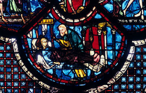 good samaritan cares pilgrim stained glass chartres