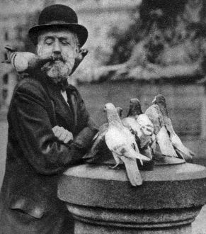 Pigeons of St Paul's with a vagrant, London, 1926-1927.Artist: McLeish