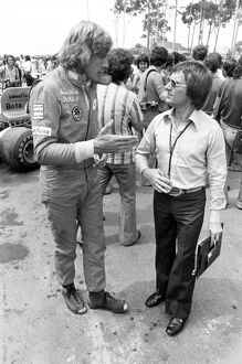James Hunt (with holes in his boots) talks to Bernie Ecclestone
