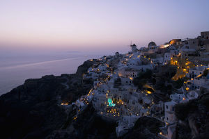 An Aerial View Of Oia And The Windmill At Dusk; Oia, Santorini, The Cyclades, The Aegean