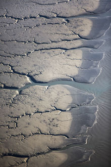 Aerial View Of Patterns Made By Water Draining Over The Silt Mud Flats Along Cook Inlet