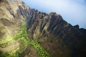 Aerial View Of The Rugged Landscape Along The Coast Of A Hawaiian Island, Na Pali
