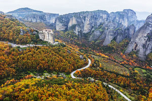 Monastery Perched On A Cliff With Autumn Coloured Foliage; Meteora, Greece