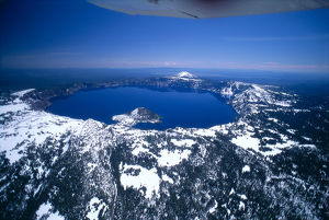 Oregon, Crater Lake, Aerial Overview, Snow Scattered, Clear Blue Sky Background A51H