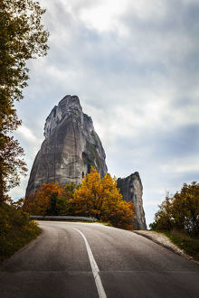 Rugged Cliffs, Road And Autumn Foliage; Meteora, Greece