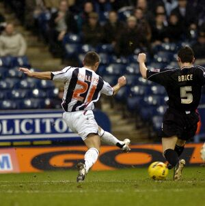 Kevin Phillips shoots at goal