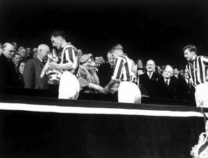 Len Millard takes the FA Cup, Jimmy Dudley receives his medal from the Queen Mother